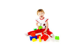 Baby girl is playing with educational toys Royalty Free Stock Image