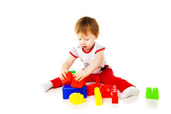Baby girl is playing with educational toys Stock Image