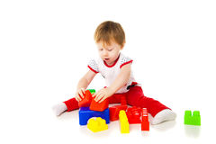 Baby girl is playing with educational toys Royalty Free Stock Photos