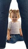 Baby girl playing and exploring. Cute baby girl with deep dark eyes playing some serious peekaboo game (isolated royalty free stock photo