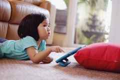 Baby girl playing games on tablet Stock Images