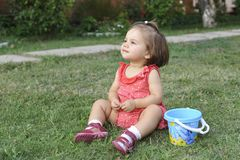 Baby Girl Is Playing On Grass Royalty Free Stock Images