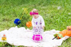 Baby girl playing on the green grass, family picnic close-up stock photos