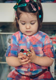 Baby girl playing with hair clips in the hands Royalty Free Stock Photo