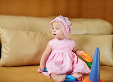 Baby girl playing at home Stock Photo