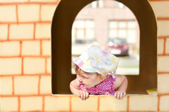 Baby girl in a playing house Stock Images