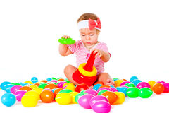 Baby Girl Playing In The Balls Royalty Free Stock Images