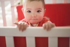 Baby girl playing just after awakening Royalty Free Stock Photos