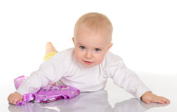 Baby girl playing with kerchief on white background Royalty Free Stock Photos