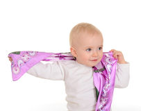 Baby girl playing with kerchief on white background Stock Photo