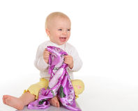 Baby girl playing with kerchief on white background Stock Images