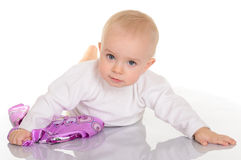 Baby girl playing with kerchief on white background Stock Photos