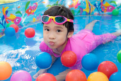 Baby girl playing in kiddie pool Royalty Free Stock Photography