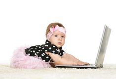 Baby girl is playing Stock Photos