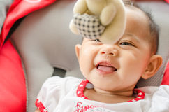 Baby girl playing with mobile in the cradle Royalty Free Stock Photo