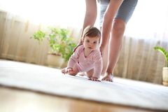 Baby girl playing with mother Royalty Free Stock Image