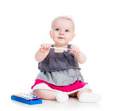 Baby girl playing musical toy Royalty Free Stock Image
