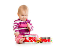 Baby girl playing musical toy Royalty Free Stock Photos