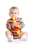 Baby girl playing with musical toy Stock Photo