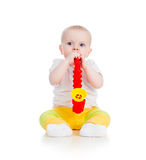 Baby girl playing musical toy Royalty Free Stock Photography