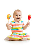 Baby girl playing musical toys stock photos