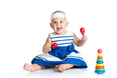 Baby girl playing with musical toys Royalty Free Stock Photo