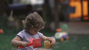 Baby Girl Playing Outdoors In The Evening stock video