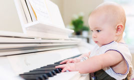 Baby girl playing the piano Royalty Free Stock Photo