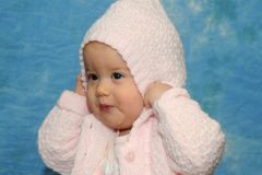 Baby girl playing pink sweater Royalty Free Stock Images