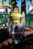 Baby girl playing in playground area Stock Images