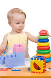 Baby girl playing pyramid Royalty Free Stock Images
