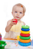 Baby girl playing pyramid Stock Image