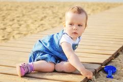 Baby girl playing sand royalty free stock photography