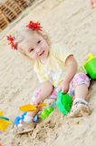 Baby girl playing in sand Royalty Free Stock Photo