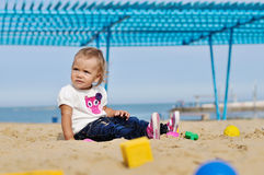 Baby girl playing in sand Royalty Free Stock Photos