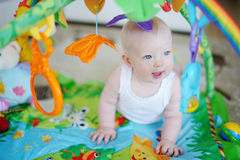 Baby girl playing with soft toys Royalty Free Stock Photo