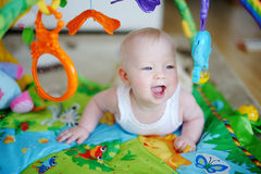 Baby girl playing with soft toys Stock Photo
