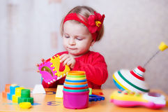 Baby girl playing sorter Stock Photos
