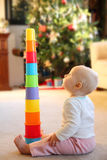 Baby Girl Playing with Stacking Cup Toy Stock Images