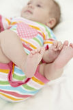 Baby Girl Playing With Toes Stock Images