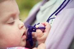 Baby girl playing with toy Stock Images