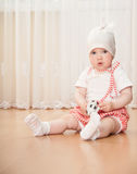 Baby girl playing with a toy Royalty Free Stock Photos