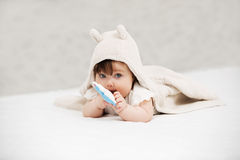 Baby girl playing with toy on blanket at home Stock Photography