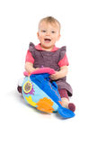 Baby girl playing with toy - isolated Royalty Free Stock Photography