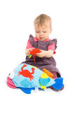 Baby girl playing with toy - isolated Royalty Free Stock Photos
