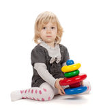 Baby girl playing with toy pyramid Royalty Free Stock Images
