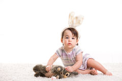 Baby girl playing with toy rabbit Royalty Free Stock Photos