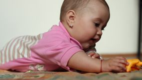 Baby Girl Playing with Toy stock footage
