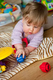 Baby girl playing with toys royalty free stock images