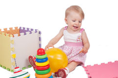 Baby girl playing toys Royalty Free Stock Photography